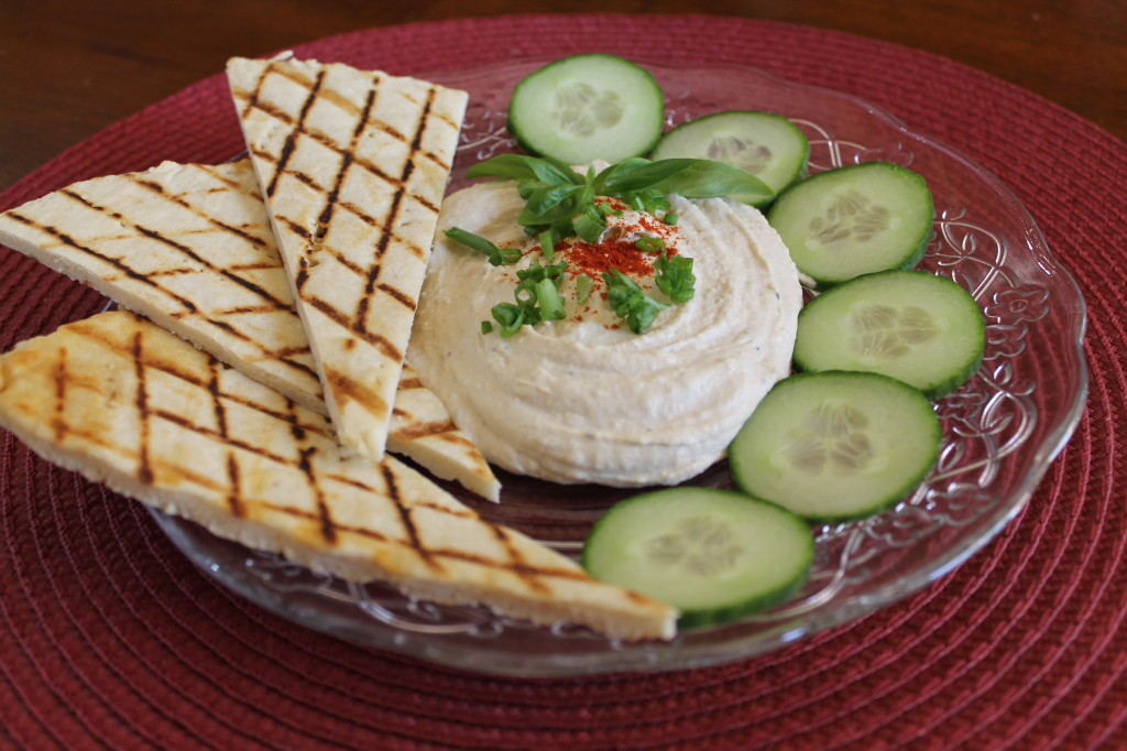 Tuscan-style Flatbread served with hummus and cucumbers for dipping.